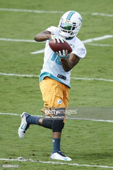 Brandon Gibson of the Miami Dolphins participates in drills during the minicamp on June 19 2014 at the Miami Dolphins training facility in Davie...