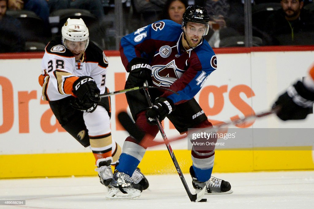 Brandon Gormley of the Colorado Avalanche controls the puck as Chris Mueller defends during the first period on Tuesday September 22 2015