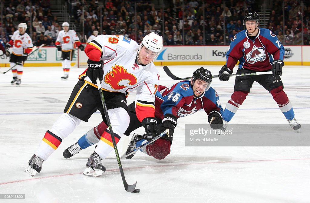 Brandon Gormley #46 of the Colorado Avalanche dives for the puck against Micheal Ferland #79 of the Calgary Flames at the Pepsi Center on January 2, 2016 in Denver, Colorado. The Flames defeated the Avalanche 4-0.