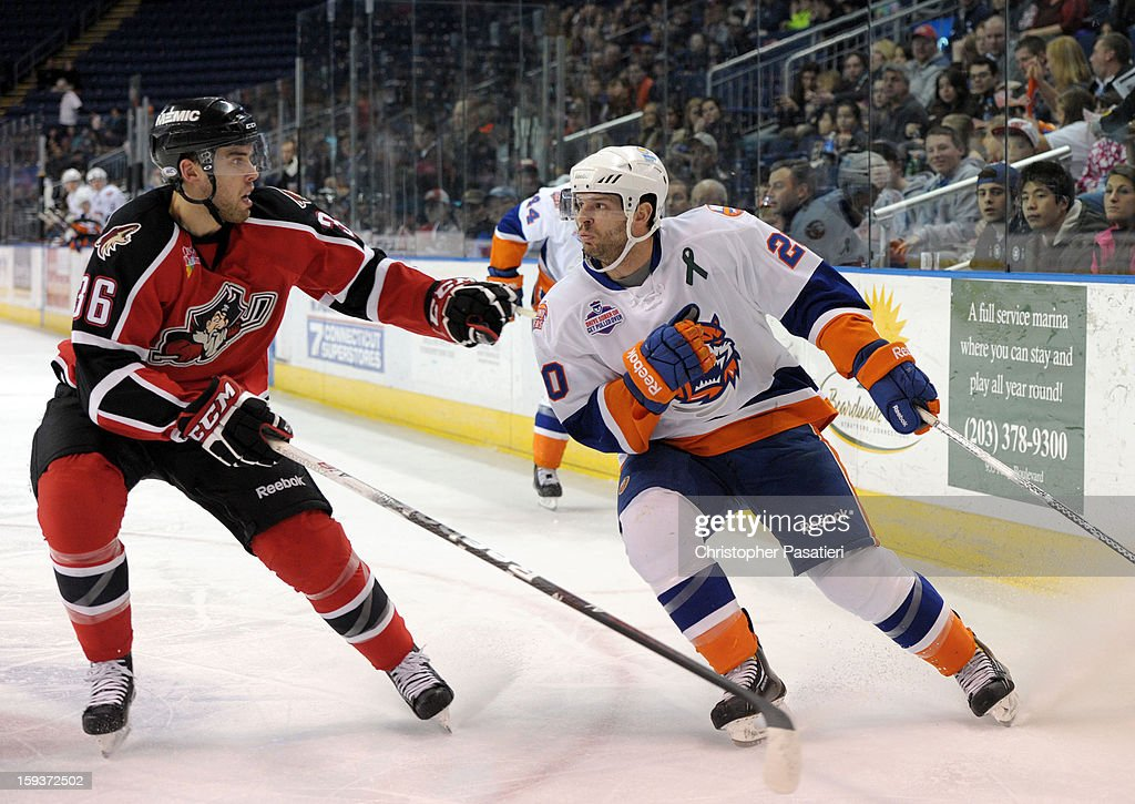 <a gi-track='captionPersonalityLinkClicked' href=/galleries/search?phrase=Brandon+Gormley&family=editorial&specificpeople=5610218 ng-click='$event.stopPropagation()'>Brandon Gormley</a> #36 of the Portland Pirates skates against Blair Riley #20 of the Bridgeport Sound Tigers during an American Hockey League game on January 12, 2013 at the Webster Bank Arena at Harbor Yard in Bridgeport, Connecticut.