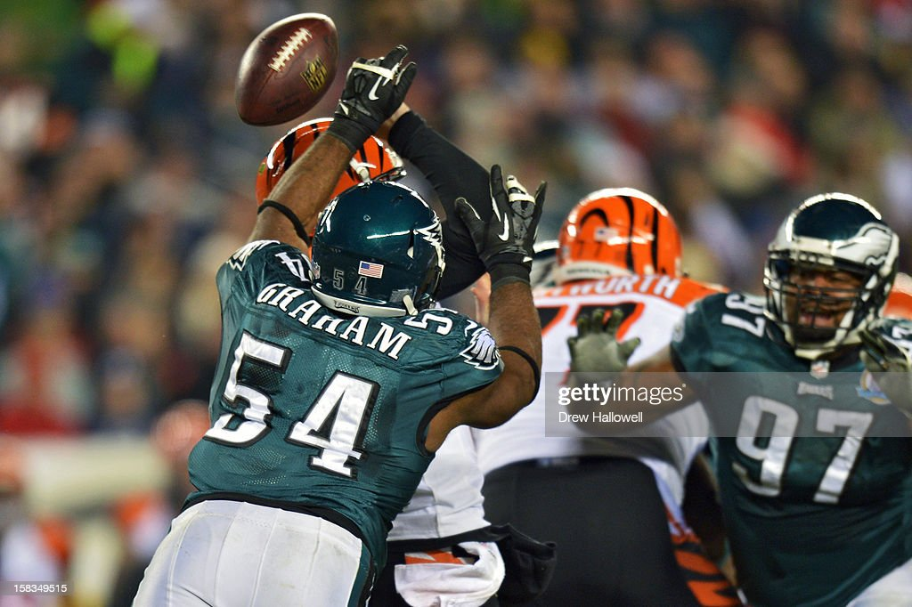 <a gi-track='captionPersonalityLinkClicked' href=/galleries/search?phrase=Brandon+Graham&family=editorial&specificpeople=4500988 ng-click='$event.stopPropagation()'>Brandon Graham</a> #54 of the Philadelphia Eagles forces a fumble while hitting <a gi-track='captionPersonalityLinkClicked' href=/galleries/search?phrase=Andy+Dalton+-+American+Football+Player&family=editorial&specificpeople=15271549 ng-click='$event.stopPropagation()'>Andy Dalton</a> #14 of the Cincinnati Bengals at Lincoln Financial Field on December 13, 2012 in Philadelphia, Pennsylvania.
