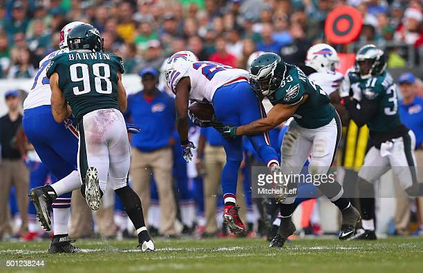 Brandon Graham of the Philadelphia Eagles tackles LeSean McCoy of the Buffalo Bills during the third quarter at Lincoln Financial Field on December...