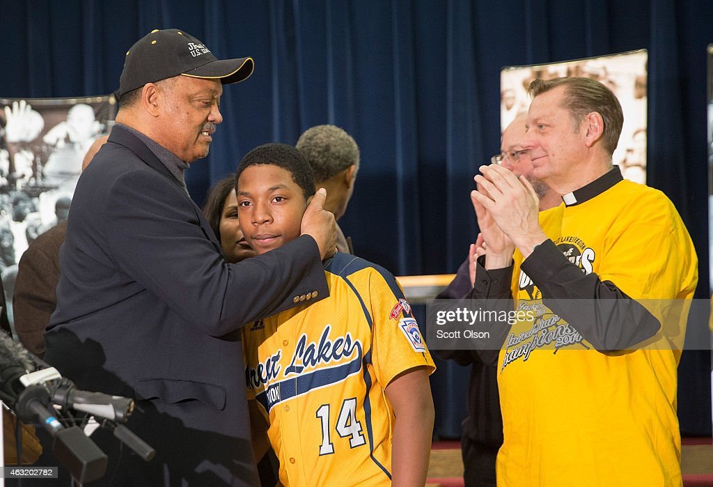 Brandon Green, a catcher and pitcher for the Jackie Robinson West Little League baseball team, is embraced by civil rights leader Rev. Jesse Jackson following a press conference that was called after the team learned it would be stripped of their national champion title on February 11, 2015 in Chicago, Illinois. The team was forced to forfeit all of their 2014 wins after the league found they had players on their roster that lived outside the team's boundaries.