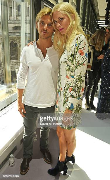 Brandon Green and Poppy Delevingne attend the Topshop Unique show during London Fashion Week SS16 at The Queen Elizabeth II Conference Centre on...
