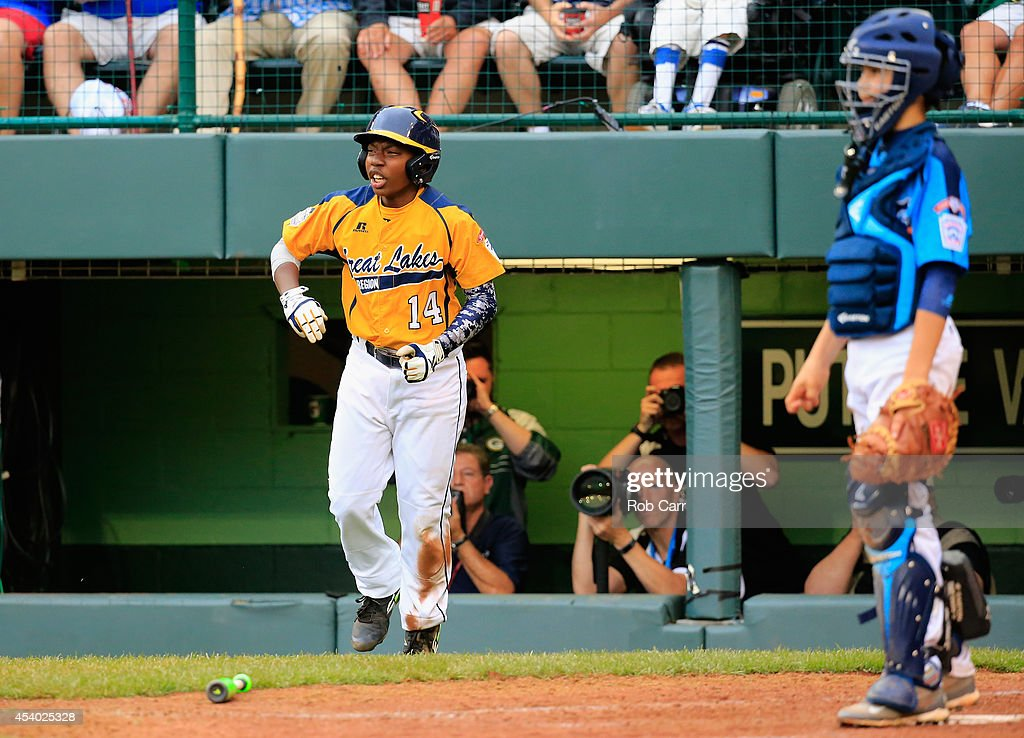 Brandon Green #14 of the Great Lakes Team from Chicago, Illinois celebrates after scoring a run in the fifth inning against the West Team from Las Vegas, Nevada during the United States Championship game of the Little League World Series at Lamade Stadium on August 23, 2014 in South Williamsport, Pennsylvania.