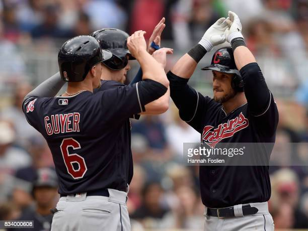 Brandon Guyer and Bradley Zimmer of the Cleveland Indians congratulate teammate Yan Gomes on a threerun home run against the Minnesota Twins during...
