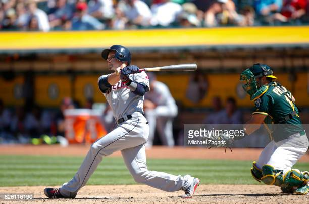 Brandon Guyer of the Cleveland Indians bats during the game against the Oakland Athletics at the Oakland Alameda Coliseum on July 16 2017 in Oakland...