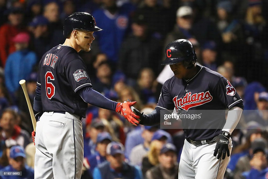 Brandon Guyer #6 of the Cleveland Indians (L) congratulates Jose Ramirez #11 after Ramirez hit a home run in the second inning against the Chicago Cubs in Game Five of the 2016 World Series at Wrigley Field on October 30, 2016 in Chicago, Illinois.