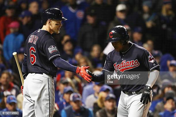 Brandon Guyer of the Cleveland Indians congratulates Jose Ramirez after Ramirez hit a home run in the second inning against the Chicago Cubs in Game...