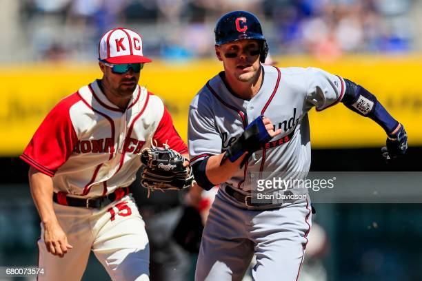 Brandon Guyer of the Cleveland Indians is caught in a run down by Whit Merrifield of the Kansas City Royals during the seventh inning at Kauffman...