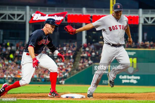 Brandon Guyer of the Cleveland Indians is safe at first as starting pitcher Eduardo Rodriguez of the Boston Red Sox misses the tag during the fourth...