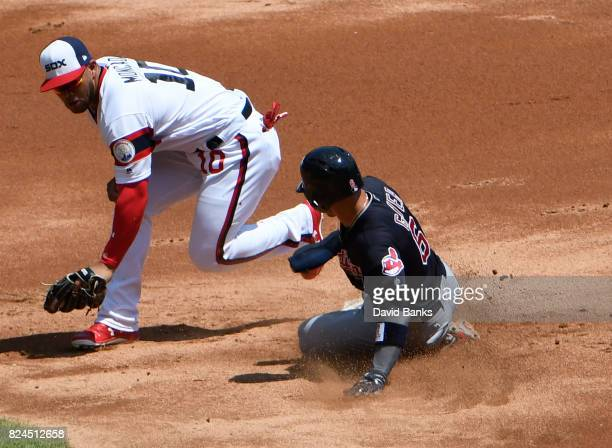 Brandon Guyer of the Cleveland Indians is safe at second base as Yoan Moncada of the Chicago White Sox make a tag during the second inning on July 30...