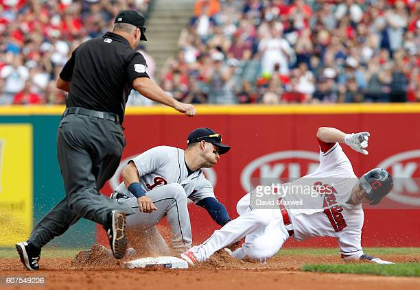 Brandon Guyer of the Cleveland Indians is safe at second base with an an RBI double to score Carlos Santana as Jose Iglesias of the Detroit Tigers...