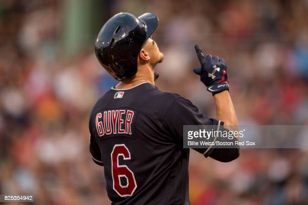 Brandon Guyer of the Cleveland Indians reacts after hitting a two run home run during the second inning of a game against the Boston Red Sox on...