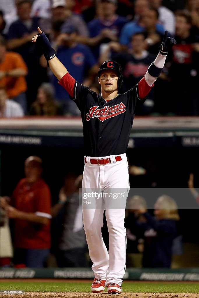 Brandon Guyer #6 of the Cleveland Indians reacts after scoring a run on a two-run home run hit by Rajai Davis #20 (not pictured) during the eighth inning against the Chicago Cubs in Game Seven of the 2016 World Series at Progressive Field on November 2, 2016 in Cleveland, Ohio.