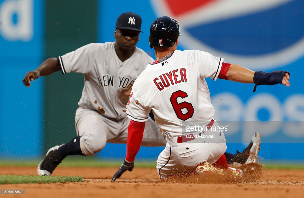 Brandon Guyer #6 of the Cleveland Indians steals second base safely against Didi Gregorius #18 of the New York Yankees in the fifth inning at Progressive Field on August 4, 2017 in Cleveland, Ohio.