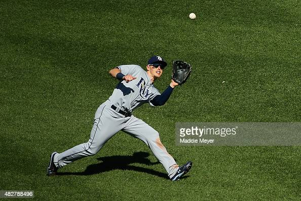 Brandon Guyer of the Tampa Bay Rays catches a fly ball hit by Xander Bogaerts of the Boston Red Sox during the seventh inning at Fenway Park on...
