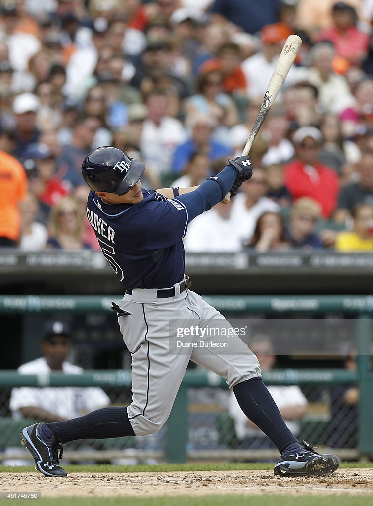 Brandon Guyer #5 of the Tampa Bay Rays hits a sacrifice fly ball to drive in Matt Joyce during the sixth inning of a game against the Detroit Tigers at Comerica Park on July 5, 2014 in Detroit, Michigan. The Rays defeated the Tigers 7-2.