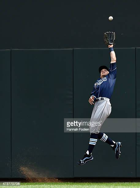 Brandon Guyer of the Tampa Bay Rays makes a catch in right field of the ball hit by Eddie Rosario of the Minnesota Twins during the second inning of...