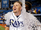 Brandon Guyer of the Tampa Bay Rays reacts as he gets a bucket of ice poured on him to celebrate a win over the Los Angeles Dodgers in a game at...