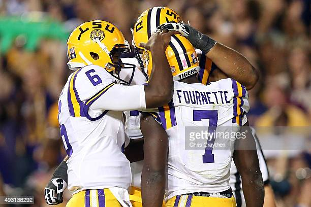 Brandon Harris celebrates with Leonard Fournette of the LSU Tigers after scoring a touchdown against the Florida Gators at Tiger Stadium on October...