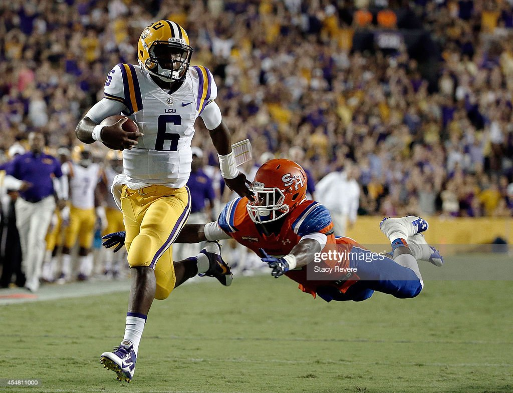 Brandon Harris of the LSU Tigers avoids a tackle by Mikell Everette of the Sam Houston State Bearkats during a game at Tiger Stadium on September 6...