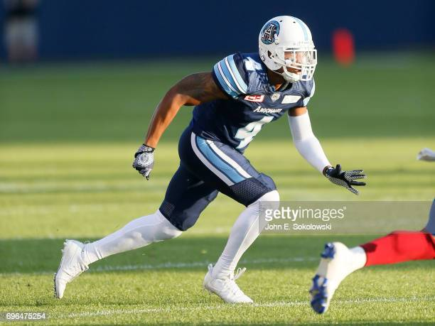 Brandon Harris of the Toronto Argonauts covers a Montreal Alouettes player during a CFL preseason game at BMO field on June 8 2017 in Toronto Ontario...