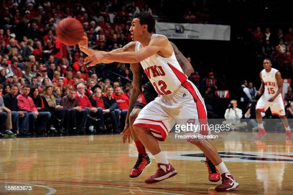 Brandon Harris of the Western Kentucky Hilltoppers passes the ball against the Louisville Cardinals at Bridgestone Arena on December 22 2012 in...