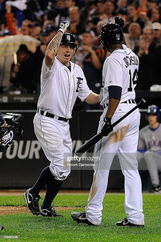 Brandon Inge #15 of the Detroit Tigers celebrates after a solo home run with Austin Jackson #14 of the Detroit Tigers in the seventh inning of Game Four of the American League Championship Series at Comerica Park on October 12, 2011 in Detroit, Michigan.