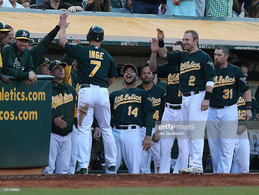 <a gi-track='captionPersonalityLinkClicked' href=/galleries/search?phrase=Brandon+Inge&family=editorial&specificpeople=204688 ng-click='$event.stopPropagation()'>Brandon Inge</a> #7 of the Oakland Athletics celebrates with teammates after scoring on a Derek Norris single in the 3rd inning against the Boston Red Sox during a Major League Baseball game at the O.co Coliseum on September 1, 2012 in Oakland, California.