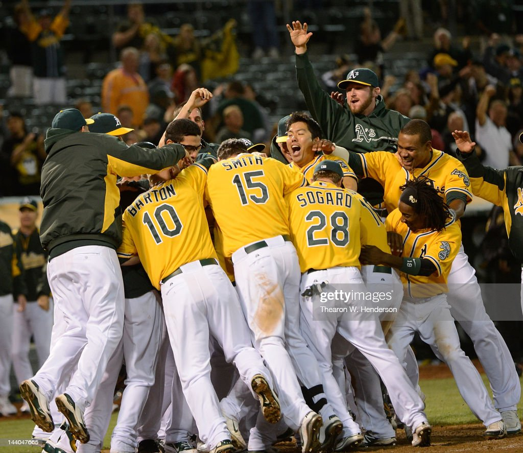 Brandon Inge #7 of the Oakland Athletics gets smothered by his teammates after he hits a walk off grand-slam home run in the ninth inning to defeat the Toronto Blue Jays 7 to 3 at O.co Coliseum on May 8, 2012 in Oakland, California.