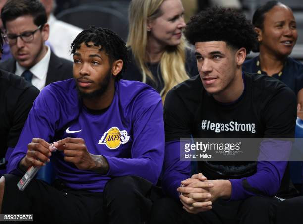 Brandon Ingram and Lonzo Ball of the Los Angeles Lakers sit on the bench during their preseason game against the Sacramento Kings at TMobile Arena on...