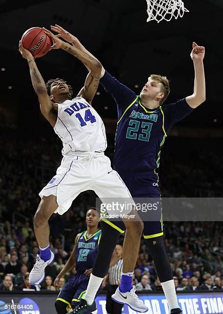 Brandon Ingram of the Duke Blue Devils drives to the basket as he is defended by CJ Gettys of the North CarolinaWilmington Seahawks in the second...