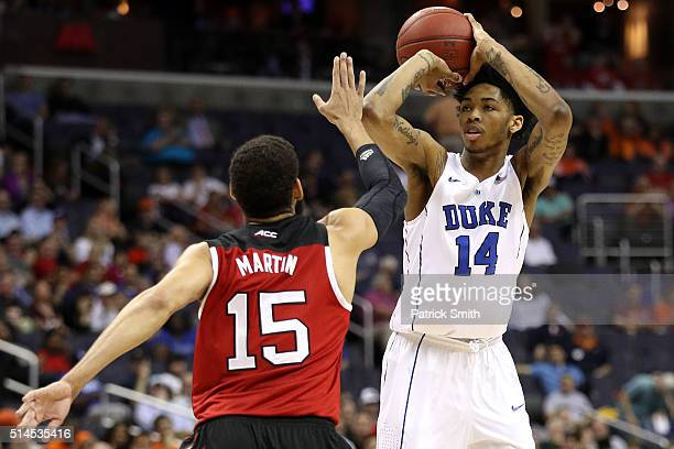 Brandon Ingram of the Duke Blue Devils shoots in front of Cody Martin of the North Carolina State Wolfpack during the first half in the second round...