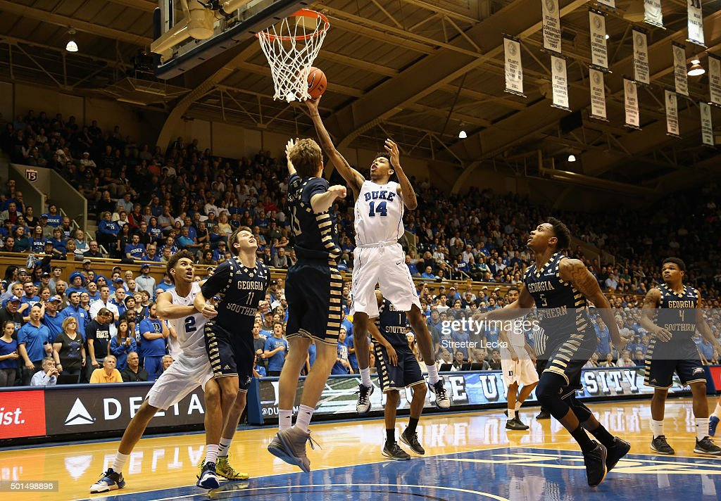 Brandon Ingram of the Duke Blue Devils shoots over Jake Allsmiller of the Georgia Southern Eagles during their game at Cameron Indoor Stadium on...