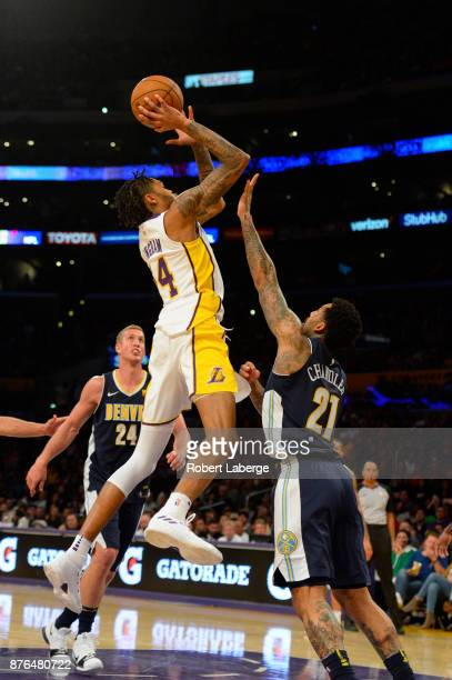 Brandon Ingram of the Los Angeles Lakers attempts a jump shot against Wilson Chandler of the Denver Nuggets on November 19 2017 at STAPLES Center in...