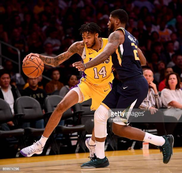 Brandon Ingram of the Los Angeles Lakers attempts to dribble past Royce O'Neale of the Utah Jazz during the first half at Staples Center on October...