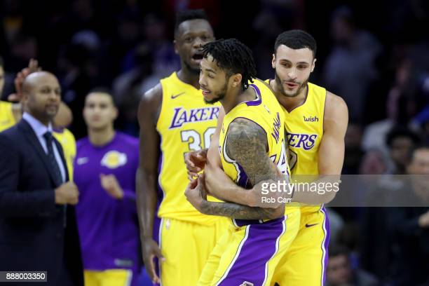 Brandon Ingram of the Los Angeles Lakers celebrates with Larry Nance Jr #7 after Ingram hit the game winning three pointer to give the Lakers a...