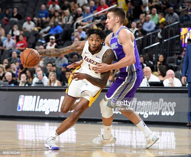 Brandon Ingram of the Los Angeles Lakers drives against Bogdan Bogdanovic of the Sacramento Kings during their preseason game at TMobile Arena on...