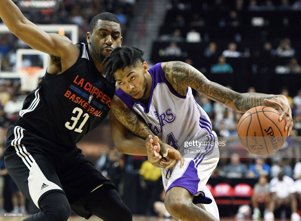 Brandon Ingram #14 of the Los Angeles Lakers drives against Hollis Thompson #31 of the Los Angeles Clippers during the 2017 Summer League at the Thomas & Mack Center on July 7, 2017 in Las Vegas, Nevada. The Clippers won 96-93 in overtime.