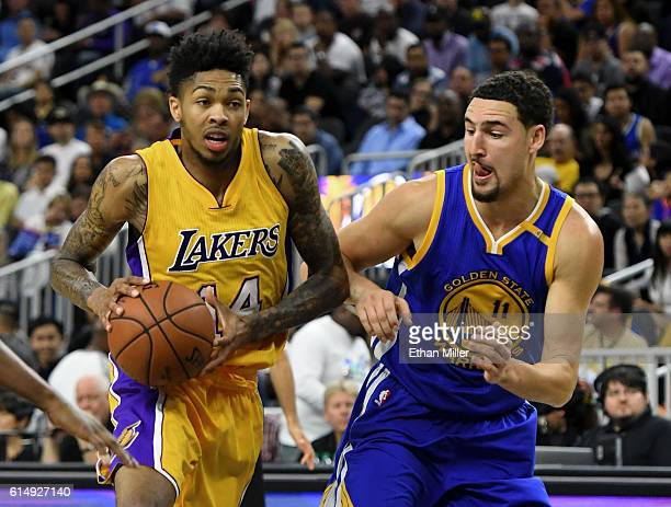Brandon Ingram of the Los Angeles Lakers drives against Klay Thompson of the Golden State Warriors during their preseason game at TMobile Arena on...
