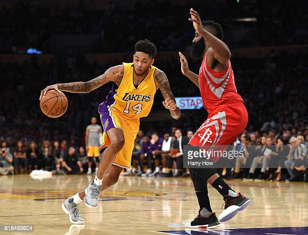 Brandon Ingram of the Los Angeles Lakers drives on James Harden of the Houston Rockets during a 120114 season opening Laker win at Staples Center on...
