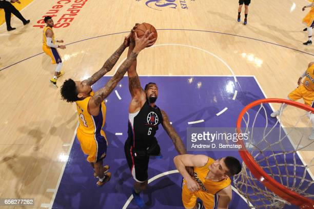 Brandon Ingram of the Los Angeles Lakers fights for a rebound against DeAndre Jordan of the LA Clippers during a game on March 21 2017 at STAPLES...