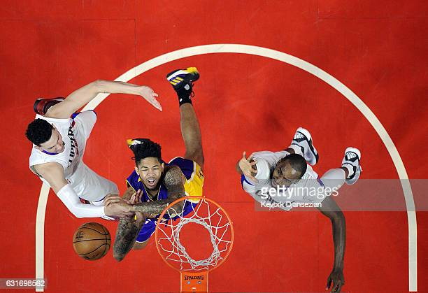 Brandon Ingram of the Los Angeles Lakers is fouled by Austin Rivers of the Los Angeles Clippers as Luc Mbah a Moute of the Los Angeles Clippers...