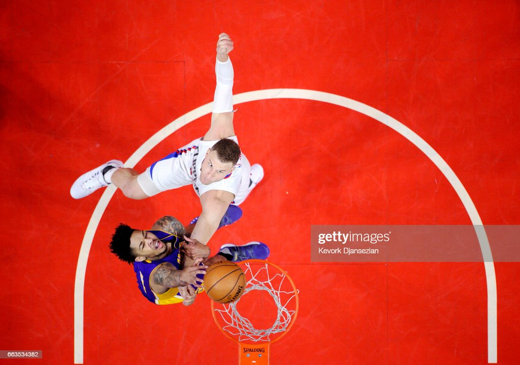 Brandon Ingram #14 of the Los Angeles Lakers is fouled by Blake Griffin #32 of the Los Angeles Clippers during the second half at Staples Center April 1, 2017, in Los Angeles, California.
