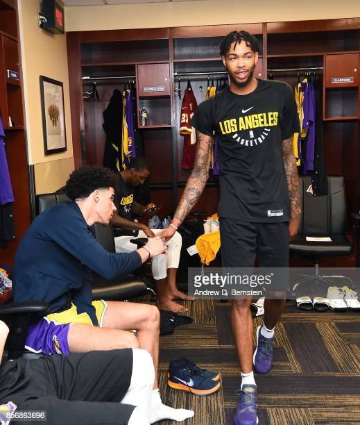 Brandon Ingram shakes hands with Lonzo Ball of the Los Angeles Lakers before the game against the Denver Nuggets during a preseason game on October 2...