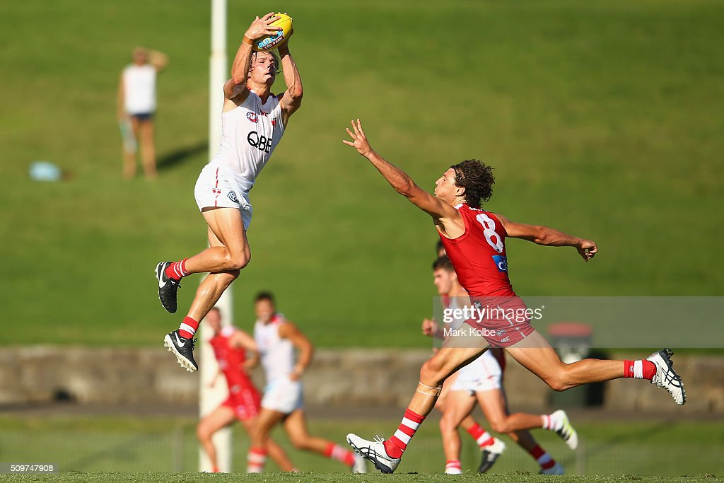 Brandon Jack of the White Team marks under pressure from Kurt Tippett of the Red Team tries to spoi;l as during the Sydney Swans AFL intra-club match at Henson Park on February 12, 2016 in Sydney, Australia.