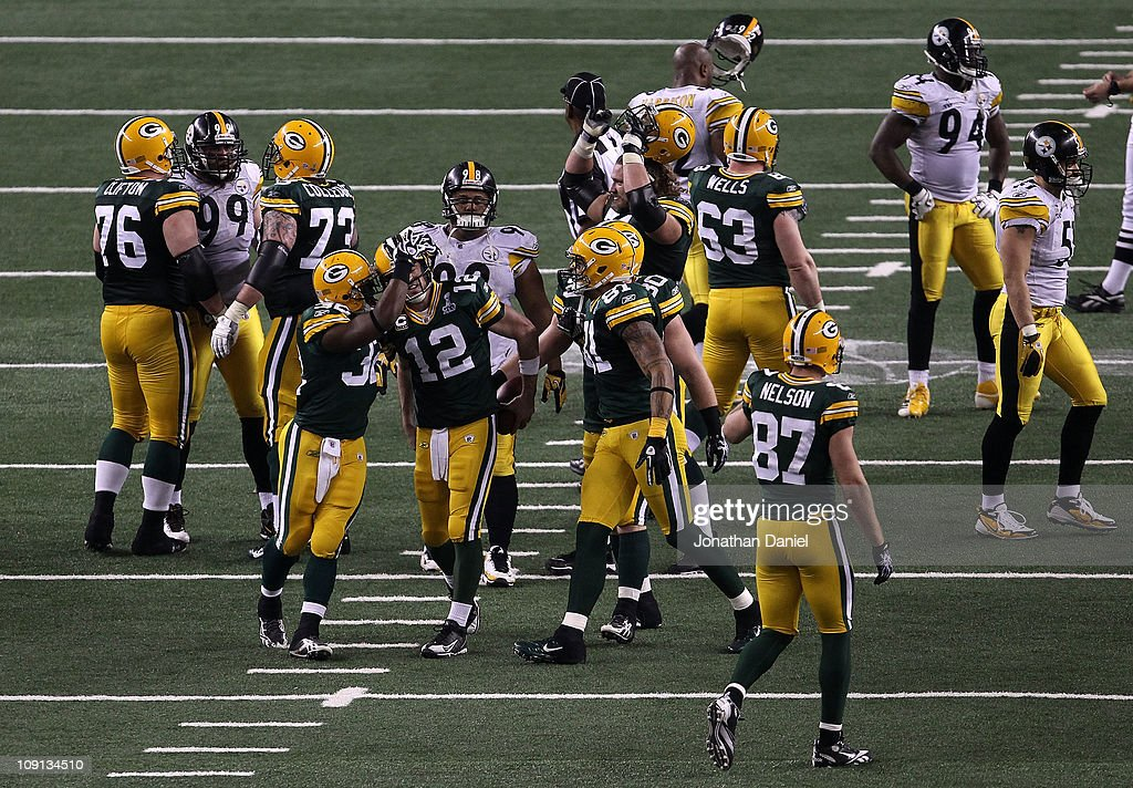 Brandon Jackson #32 and <a gi-track='captionPersonalityLinkClicked' href=/galleries/search?phrase=Aaron+Rodgers+-+American+Football+Quarterback&family=editorial&specificpeople=215257 ng-click='$event.stopPropagation()'>Aaron Rodgers</a> #12 of the Green Bay Packers celebrate as the Packers defeat the Pittsburgh Steelers 31-25 to win Super Bowl XLV at Cowboys Stadium on February 6, 2011 in Arlington, Texas.