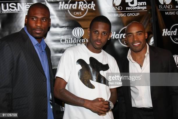 Brandon Jacobs Fabolous and Tiki Barber attend the 3rd annual Tiki Rocks The Square for the Children's Miracle Network at the Hard Rock Cafe Times...
