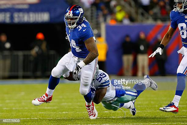 Brandon Jacobs of the New York Giants in action against the Dallas Cowboys at MetLife Stadium on November 24 2013 in East Rutherford New Jersey...